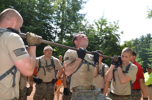 Senior Airman Francis Gelada, 103rd Security Forces Squadron, grimaces during a pull-up as his teammates hold the bar in place as part of the Connecticut SWAT Challenge on Aug. 22, 2013, at the West Hartford Reservoir, West Hartford, Conn. The Connecticut Air National Guard team grabbed eighth place overall, besting 20 other regional teams. (U.S. Air National Guard Photo by Maj. Jefferson S. Heiland)