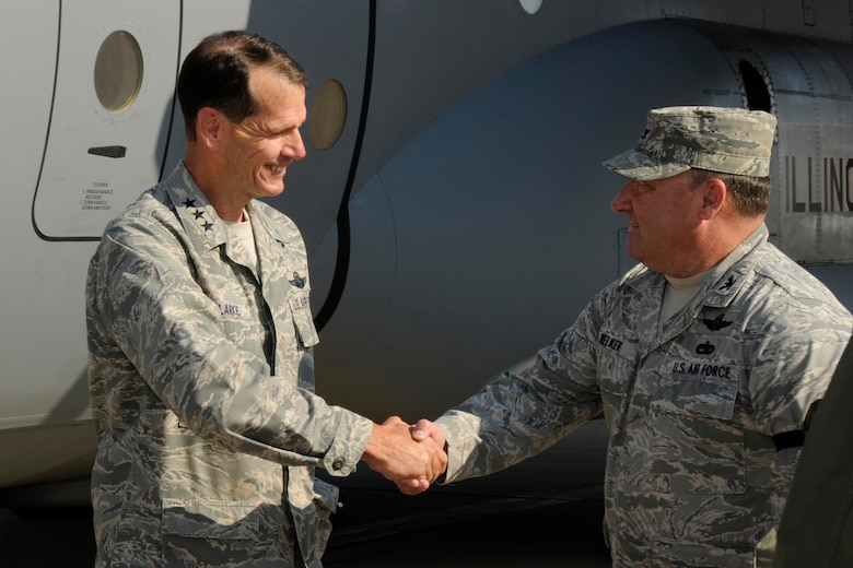 Lt. Gen. Stanley E. Clarke, Director of the Air National Guard, is greeted by Col. Barton Welker, Commander, 182nd Maintenance Group, after arriving for a site visit at the182nd Airlift Wing in Peoria, Ill. Sep. 6, 2013. (Air National Guard photo by Tech. Sgt. Todd Pendleton/released)