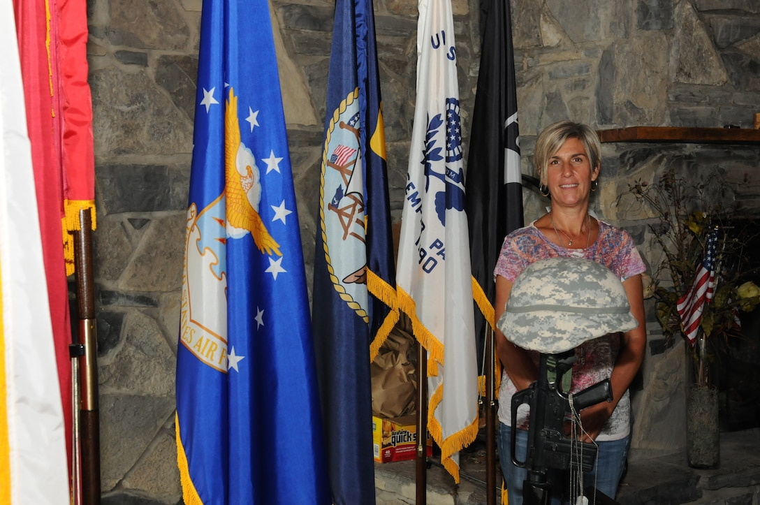Melissa Spicer, co-founder and president of the Board of Directors for Clear Path for Veterans, stands in front of the fallen soldier memorial at the Clear Path facility located in Chittenango, NY on 7 September 2013. Clear Path is a community based veteran outreach center which provides a place for veterans to go for information on several different programs and services that go beyond standard healthcare and education. (New York Air National Guard Photo by Senior Airman Duane Morgan)