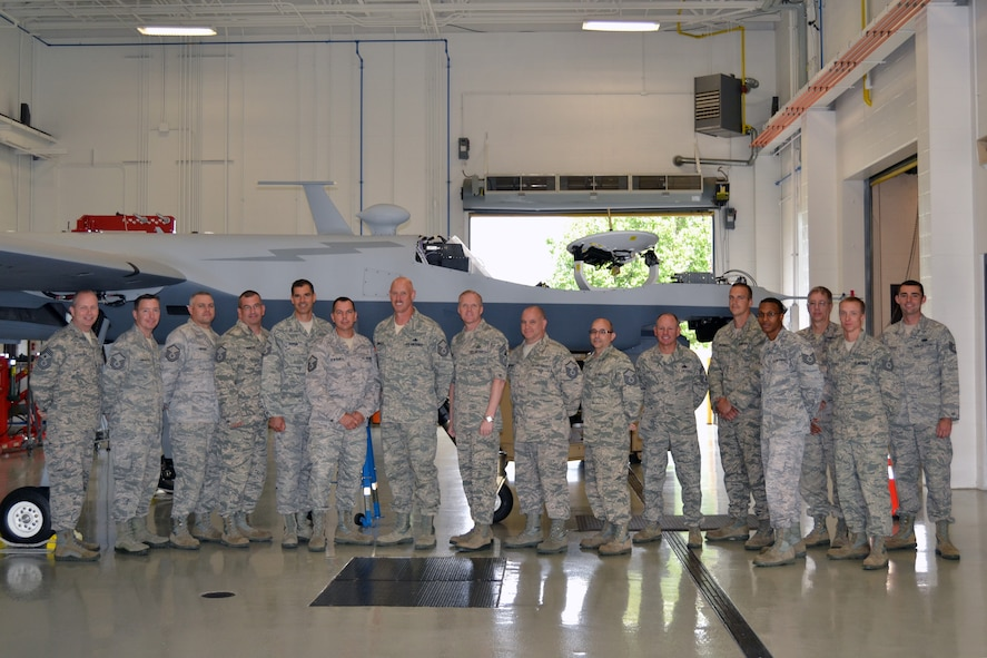 Chief Master Sgt. of the Air Force James A. Cody (eigth from left), along with Command Chief Master Sgt. James Hotaling of the Air National Guard, toured the 174th Attack Wing, Hancock Field on Sep. 7, 2013. Cody visited Hancock Field to meet with Airmen, get the pulse of the enlisted force and answer questions. Cody, Hotaling and MQ-9 maintenance trainers take time to pose in front of the Reaper. (Photo by New York Air National Guard Maj. Sandra Stoquert)
