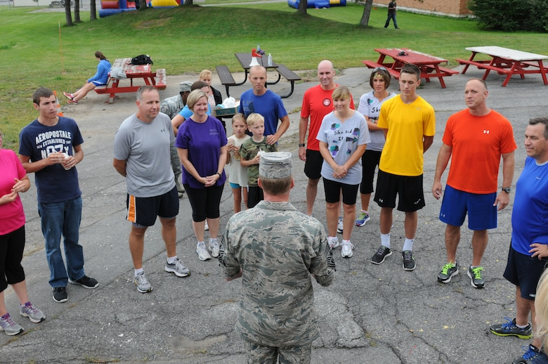Chief Master Sgt. of the Air Force James A. Cody meets Airmen and family members after the Family Fun Run at the 174th Attack Wing, Hancock Field on Sep. 7, 2013. Cody visited Hancock Field to meet with Airmen, get the pulse of the enlisted force and answer any questions. (Photo by New York Air National Guard Tech. Sgt. Justin A. Huett)