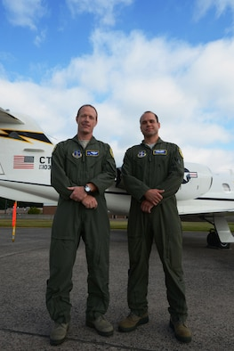 Lt. Col. Walt Levantovich and Capt. Garrett Caponetti, both pilots with the 103rd Airlift Wing, Connecticut Air National Guard, pose in front of one of the wing's C-21s at Bradley Air National Guard Base, East Granby, Conn., Sept. 8, 2013. Levantovich and Caponetti stopped at the scene of a multi-vehicle crash and rendered first aid to two children after rescuing them from an overturned vehicle September 6. The severity of the accident caused a shutdown of all southbound traffic on I-91 in Windsor, Conn. (U.S. Air National Guard photo by Senior Airman Jennifer Pierce)
