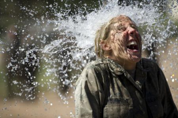 Cadet 4th Class Leah Young cools off during Basic Cadet Training in Jacks Valley in July. Young, a prior-enlisted Airman, was accepted into the Air Force Academy's Class of 2017 on Aug. 6, 2013.