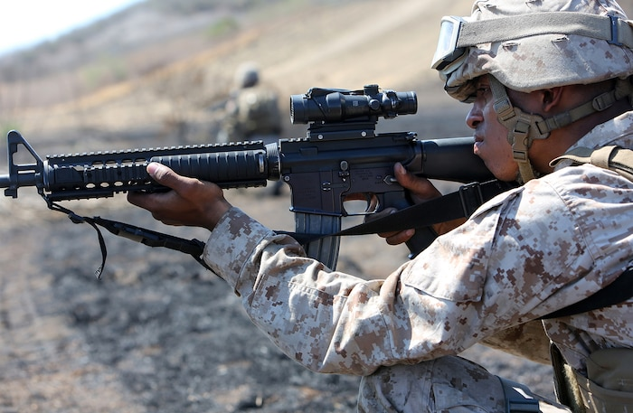 A Marine with Combat Logistics Battalion 5, 1st Marine Logistics Group, provides security during a combat operations center exercise aboard Camp Pendleton, Calif., Sept. 5, 2013. The COCEX requires Marines to rapidly set up, disassemble and displace command nodes in an expeditionary environment.
