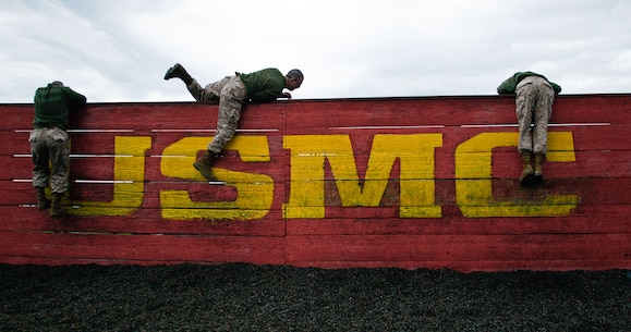 Recruits of Golf, Company, 2nd Recruit Training Battalion, climb over a wall during the obstacle course Feb. 25, 2013 on Parris Island.