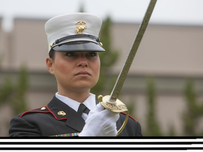 Sgt. Steffany Ismaili, an aviation electrician with Marine Aviation Logistics Squadron 11, conducts sword manual during a morning colors ceremony, in honor of Women's History Month, aboard Marine Corps Air Station Miramar, Calif., March 18. The sergeant was used to symbolize women in the Marine Corps. (Official USMC released)