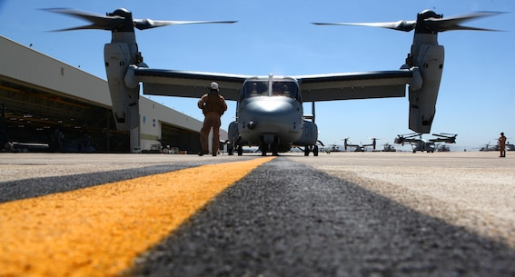 An Osprey with Marine Medium Tiltrotor Squadron 165 runs as pilots perform pre-flight preparations before Maj. Gen. Gregg Sturdevant, 3rd Marine Aircraft Wing assistant wing commander, takes his final flight with the wing aboard Marine Corps Air Station Miramar, Calif., May 14. Sturdevant wanted to take one last flight with 3rd MAW and felt it fitting he fly with his former squadron.