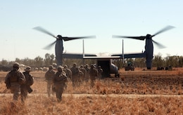 "Marines with Lima Company, 3rd Battalion, 3rd Marine Regiment, Marine Rotational Force - Darwin, load into an MV-22B Osprey from the 31st Marine Expeditionary Unit during Exercise Koolendong, here, Sept. 3. MRF-D Marines traveled to the range either by foot, vehicle or aircraft. This training evolution is the first of its kind, here, in which Marines with MRF-D and the 31st MEU worked bilaterally with the Australian soldiers of Bravo Company, 5th Battalion, Royal Australian Regiment as a ""proof of concept"" to assess the capacity of the training ranges to support a battalion-sized live-fire event."