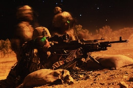 "Lance Cpl. Justin Oates, machine gunner, Weapons Platoon, Lima Company, 3rd Battalion, 3rd Marine Regiment, Marine Rotational Force - Darwin, engages a simulated enemy force with an M240B machine gun, here, Sept. 2. Throughout the exercise, MRF-D Marines conducted day and night live-fire training. This training evolution is the first of its kind here in which Marines with MRF-D and the 31st Marine Expeditionary Unit worked bilaterally with the Australian soldiers of Bravo Company, 5th Battalion, Royal Australian Regiment as a ""proof of concept"" to assess the capacity of the training ranges to support a battalion-sized live-fire event."