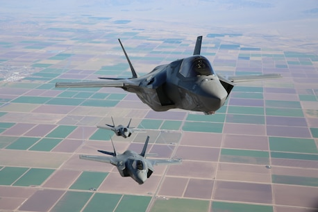 Three F-35B Lightning II Joint Strike Fighters with Marine Fighter Attack Squadron 121, 3rd Marine Aircraft Wing, fly in formation during fixed-wing aerial refueling training over eastern California, Aug. 27. VMFA-121 is the first F-35B squadron in the Marine Corps. (Photo by Lance Cpl. Michael Thorn)