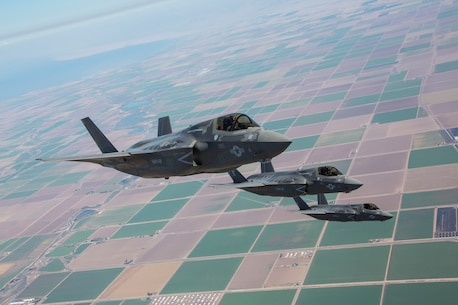 Three F-35B Lightning II Joint Strike Fighters with Marine Fighter Attack Squadron 121, 3rd Marine Aircraft Wing, fly in formation during fixed-wing aerial refueling training over eastern California, Aug. 27. VMFA-121 is the first F-35B squadron in the Marine Corps.