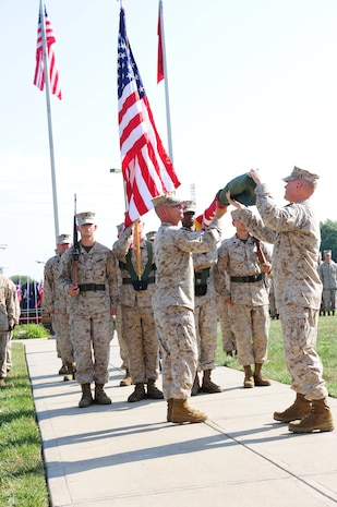 Col. Charles Sides, the commanding officer of 24th Marine Regiment, uncases the Combat Logistics Regiment 4 colors during a ceremony Sept. 8 in Kansas City, Mo. The ceremony marks the end of the 24th Marine Regiments prestigious history.