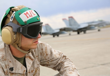 Sgt. Ryan Shouse, a maintenance control non-commissioned officer with Marine Fighter Attack Squadron 232 and a Scottsburg, Ind., native, watches as F/A-18C Hornets launch from the flight line aboard Mountain Home Air Force  Base, Idaho, July 24. Marines with maintenance control ensure all maintenance is completed and there are no issues with the aircraft.
