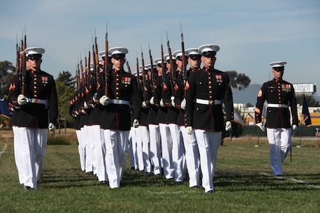 Marines with the Silent Drill Platoon perform during a Battle Colors Ceremony aboard Marine Corps Air Station Miramar, Calif., March 14. With a reputation of perfection throughout the world, the silent drill platoon reminds onlookers of the proud esprit de corps found in Marines serving all around the globe.
