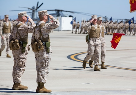 Col. Patrick Gramuglia, left, former commanding officer of Marine Aircraft Group 16, and Col. Anthony Bianca, right, incoming commanding officer of MAG-16, salute during a change of command ceremony aboard Marine Corps Air Station Miramar, Calif., Aug. 8. Gramuglia relinquished his duties to Bianca, who came from the previous command of Marine Medium Tiltrotor Squadron 261.