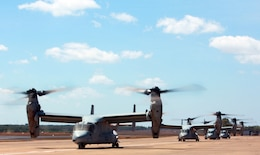 After refueling, four MV-22B Ospreys with Marine Medium Tiltrotor Squadron 265, 31st Marine Expeditionary Unit, wait to depart for Bradshaw Field Training Area for Exercise Koolendong, here, Aug. 28. During this exercise, Marines with MRF-D and the 31st MEU will work bilaterally with Australian soldiers from Bravo Company, 5th Battalion, Royal Australian Regiment.
