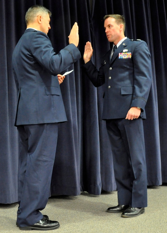 The NV ANG welcomed its newest O-6 in a ceremony at the Air Guard Base in Reno on Sunday.  Air Wing commander, Col. Burkett (left) reads the oath of office to Col. Clark the vice wing commander (right).  NV ANG photo by Tech. Sgt. Eric Ritter (released).
