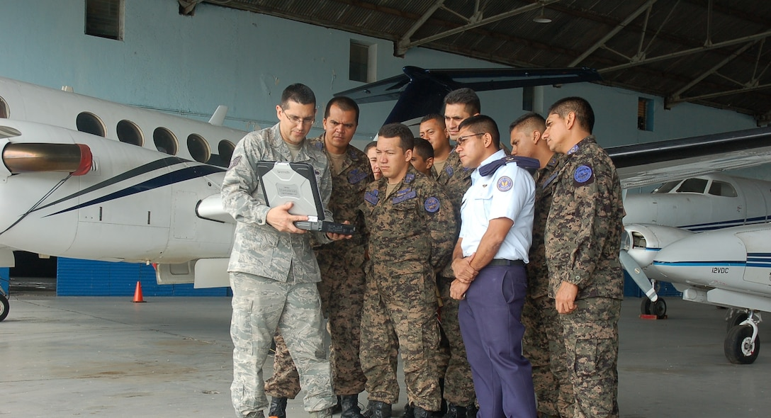 Tech. Sgt. Mauricio Moya, Inter-American Air Forces Academy aircraft maintenance instructor, shares ground safety methodologies before taking a guided tour of maintenance shops with members of the Honduran Air Force during the MSAS building partner capacity engagement, 29 Jul – 24 Aug, at Base Aerea Hector Acosta Mejia, Tegucigalpa, Honduras. (U.S. Air Force photo by Tech. Sgt. Moises Chavezzavala)