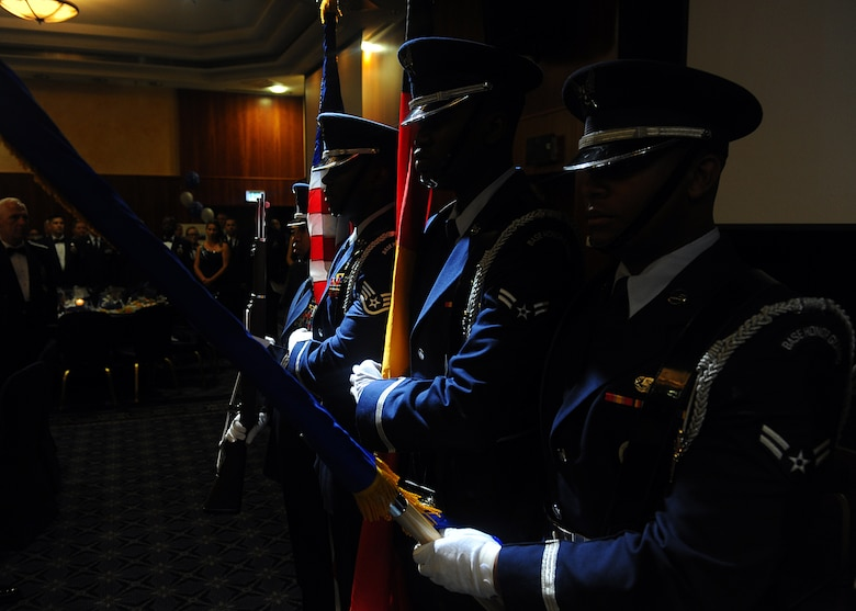 "SPANGDAHLEM AIR BASE, Germany – Members of the 52nd Force Support Squadron Honor Guard team post the colors during the singing of the U.S. and German national anthems at the Air Force Ball at Club Eifel Sept. 7, 2013. The theme for the event was ""Shining Stars … Remembering the Past … Forging the Future.""  More than 200 Airmen and family members from the Spangdahlem community joined together to celebrate and honor Air Force heritage during the ball. (U.S. Air Force photo by Staff Sgt. Daryl Knee/Released)"