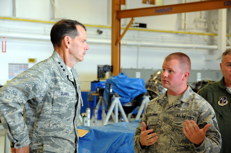 ABRAHAM LINCOLN CAPITAL AIRPORT, Illinois -- Master Sgt. Carl Hasselbring, 183d Maintenance Squadron, briefs Lt. Gen. Stanley Clarke, Director, Air National Guard, on the mission of the 183d Fighter Wing's jet engine Centraized repair Facility (CRF), a new mission at the unit. (Air National Guard photo by Master Sgt Shaun Kerr/Released)