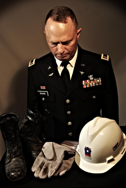 U.S. Army National Guard Chief Warrant Officer 4 Clifford Bauman reflects Aug. 22, 2013, on the boots, gloves and hat he wore during search and rescue missions at the Pentagon, Washington, D.C., after the Sept. 11, 2001 attacks. After the missions were over, Bauman placed the work gear in closet and did not touch them again until 12 years later. (U.S. Air Force photo illustration/Staff Sgt. Jarad A. Denton)