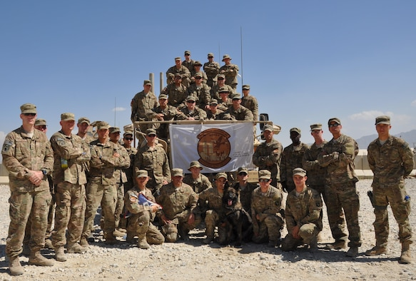 Members of the 105th Security Forces Squadron deployed from Stewart Air National Guard Base in Newburgh, New York, gather for a group photo Sept. 8, 2013, at Bagram Airfield, Afghanistan. Sept. 11, 2001, is never too far from the hearts and minds of the 105th SFS. Through mementos and each other, they remember one unit member who was killed during the attacks of Sept. 11, 2001. (U.S. Air Force photo/Tech. Sgt. Rob Hazelett)