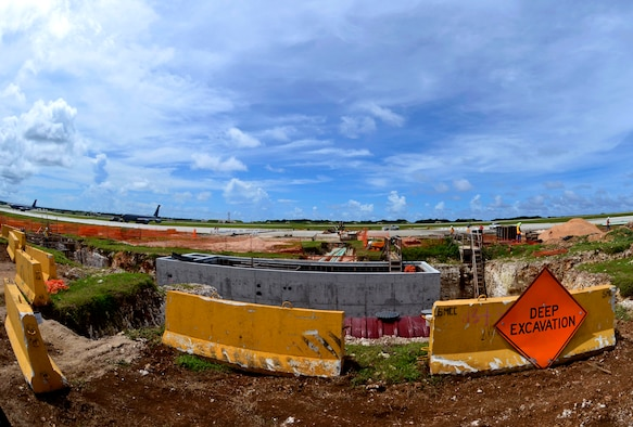 "Construction of the Guam Strike Clear Water Rinse Facility continues Sept. 5, 2013, on the Andersen Air Force Base, Guam, flightline. Department of Defense contractors and members of the 36th Civil Engineer Squadron began construction of the Guam Strike Clear Water Rinse Facility, or the ""birdbath,"" in May 2013 and are scheduled to complete the facility by December of this year. (U.S. Air Force photo by Senior Airman Marianique Santos/Released)"
