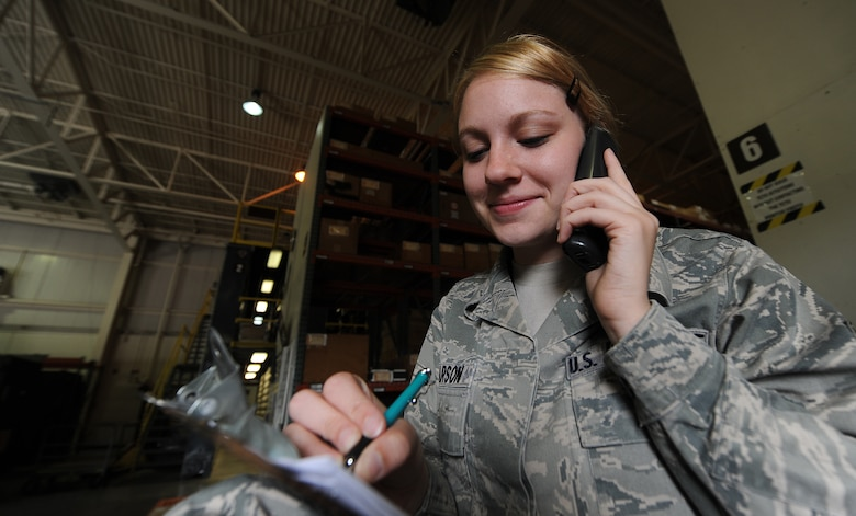 U.S. Air Force Senior Airman Sarah Pearson, 509th Logistics Readiness Squadron aircraft parts journeyman, interfaces with maintainers to order a part in the aircraft part store at Whiteman Air Force Base, Mo., Aug. 2, 2013. Part of her interfacing process includes annotating tail numbers of aircraft and other information pertinent to the order. (U.S. Air Force photo by Staff Sgt. Nick Wilson/Released)