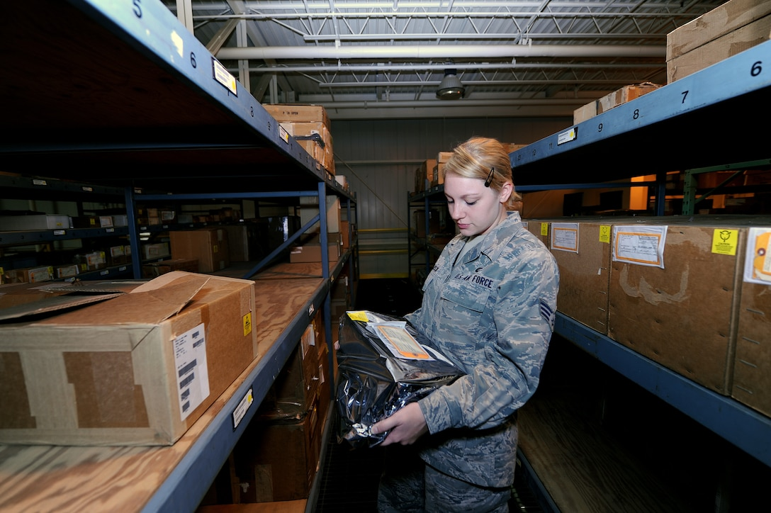 U.S. Air Force Senior Airman Sarah Pearson, 509th Logistics Readiness Squadron aircraft parts journeyman, examines an electrostatic device as part of a routine inspection in the aircraft part store at Whiteman Air Force Base, Mo., Aug. 2, 2013. Electrostatic devices must be packed with specific types of wrapping when they are stowed so the equipment is not damaged during storage. (U.S. Air Force photo by Staff Sgt. Nick Wilson/Released)
