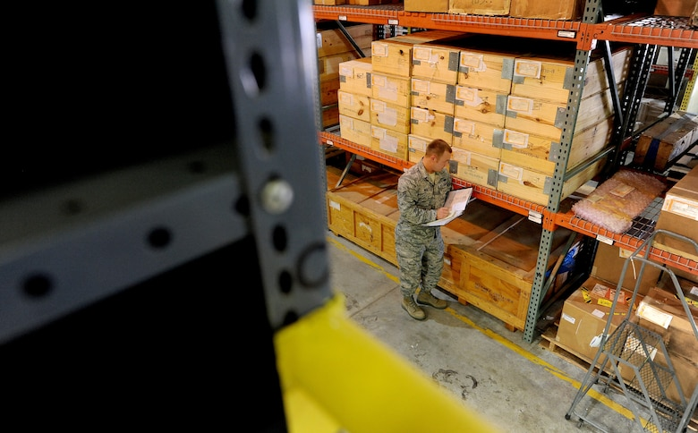 U.S. Air Force Airman 1st Class Christopher Neal, 509th Logistics Readiness Squadron aircraft parts journeyman, annotates the stock number on a piece of equipment during a routine inspection in the aircraft part store at Whiteman Air Force Base, Mo., Aug. 2, 2013. The stock numbers on items help Airmen quantify and maintain accountability of parts stored in the aircraft part store. (U.S. Air Force photo by Staff Sgt. Nick Wilson/Released)