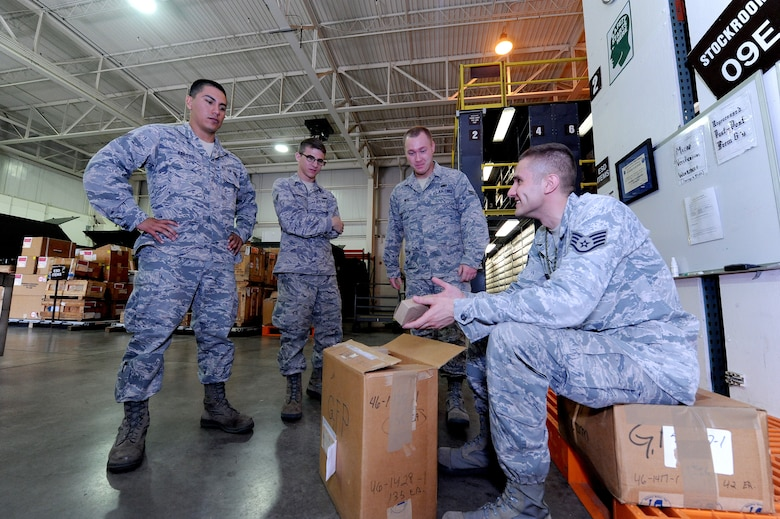 "U.S. Air Force Staff Sgt. Anton Auster, 509th Logistics Readiness Squadron aircraft part store supervisor, provides training to Airmen dealing with parts in the ""frustrated pallet"" of the aircraft part store at Whiteman Air Force Base, Mo., Aug. 2, 2013. The frustrated pallet is used for items in the warehouse that need repair. (U.S. Air Force photo by Staff Sgt. Nick Wilson/Released)"