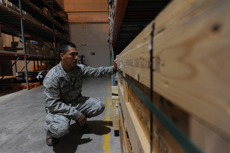 U.S. Air Force Senior Airman Emmanuel Arroyo, 509th Logistics Readiness Squadron aircraft part store journeyman, verifies the stock number of a part at the aircraft part store at Whiteman Air Force Base, Mo. Aug. 2, 2013. The stock numbers on items help Airmen quantify and maintain accountability of parts stored in the aircraft part store. (U.S. Air Force photo by Staff Sgt. Nick Wilson/Released)