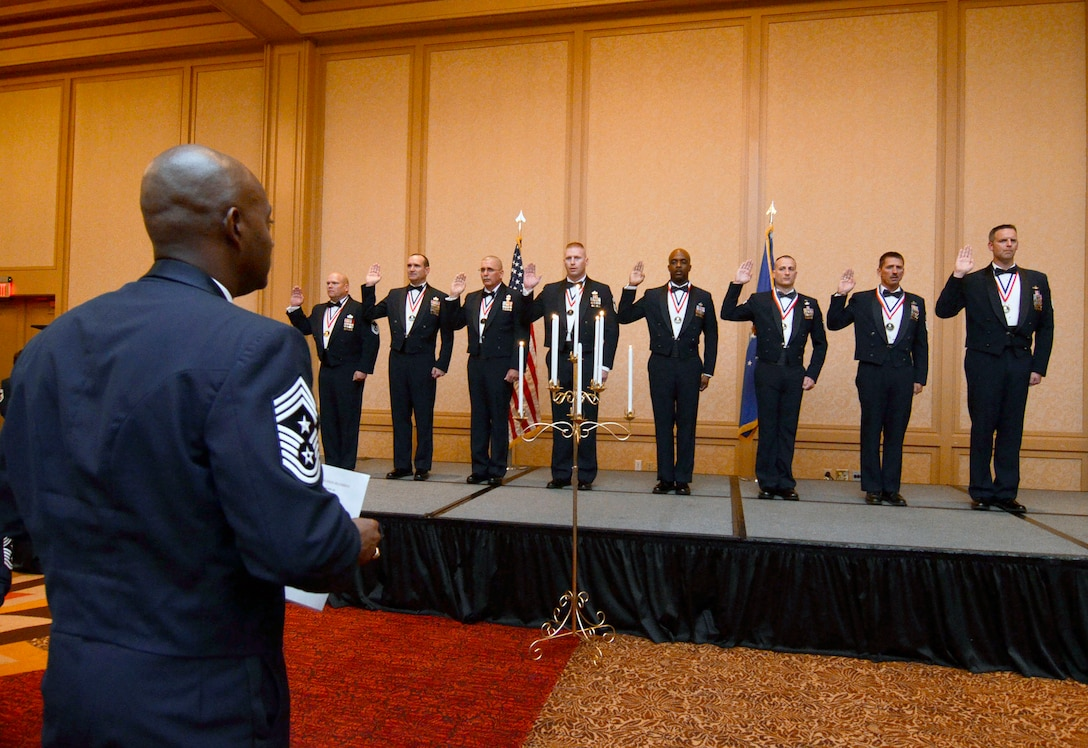 Chief Master Sgt. Cameron B. Kirksey, 16th Command Chief, United States Air Force Reserve Command, Robins Air Force Base, Ga., recites the chiefs' oath to eight chief inductees during the official recognition portion of the 2013 Dobbins Chief's Recognition Ceremony held at the Renaissance Waverly Hotel, Atlanta, Ga., Sep. 7. (U.S. Air Force photo/Don Peek)