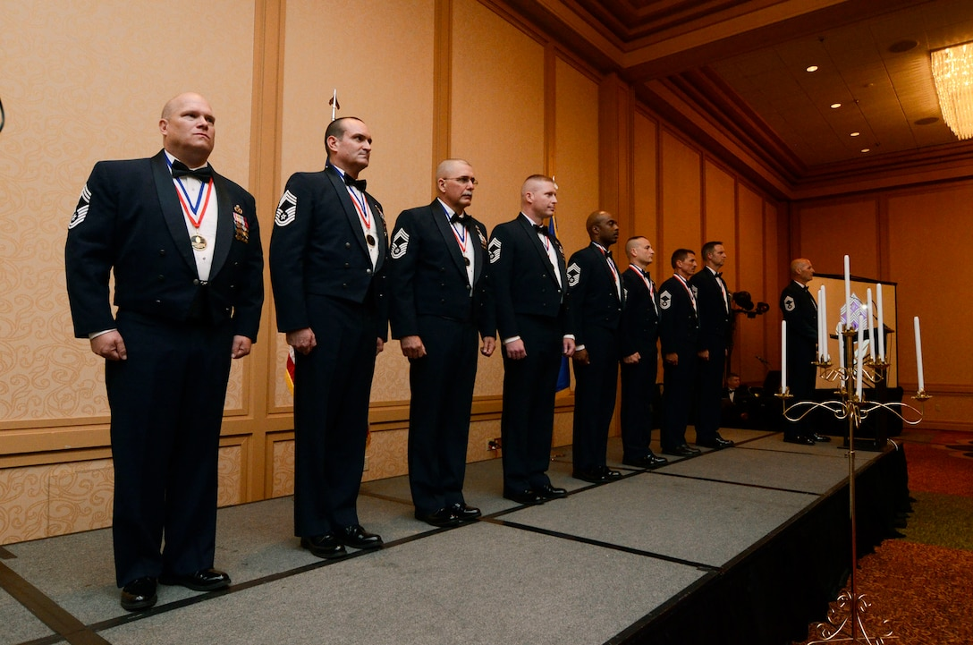Eight Chief Master Sgt. Inductee's line-up as they prepare for the official recognition and candle lighting portion of the 2013 Dobbins Chief's Recognition Ceremony held at Renaissance Waverly Hotel, Atlanta, Ga., Sep. 7. (U.S. Air Force photo/Don Peek)