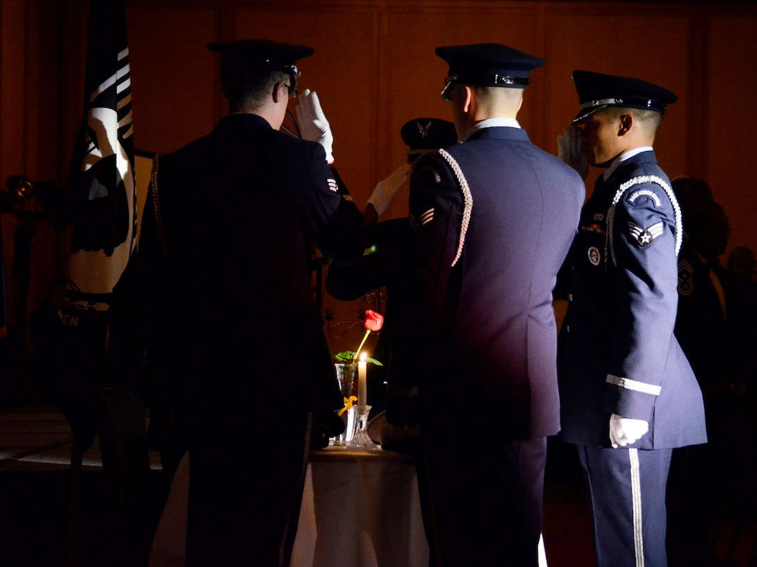 The 94th Airlift Wing Honor Guard, Dobbins Air Reserve Base, Ga., performs the Prisoner of War/Missing in Action (POW/MIA) Remembrance Ceremony during 2013 Dobbins Chief's Recognition Ceremony held at the Renaissance Waverly Hotel, Atlanta, Ga., Sep. 7. (U.S. Air Force photo/Don Peek)