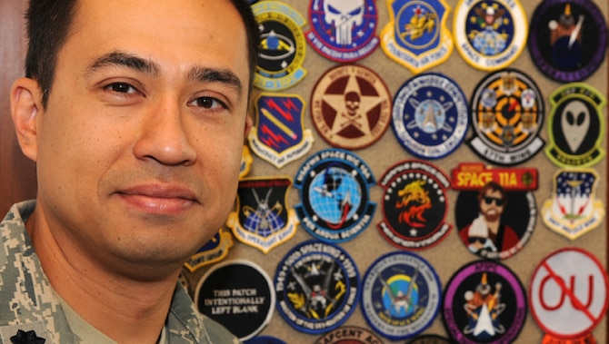 Lt. Col. Rich Operhall shows off a portion of his collection of more than 15,000 patches. Operhall began collecting patches in junior high and his collection fuels his passion of Air Force history and heritage. Operhall is the commander of the 76th Space Control Squadron.