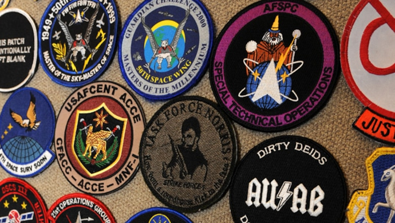 A portion of Lt. Col. Rich Operhall's collection of more than 15,000 patches are on display in his office at Peterson Air Force Base, Colo. Operhall began collecting patches in junior high. Openhall is the commander of the 76th Space Control Squadron.