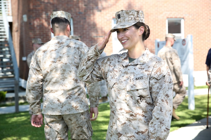 Navy Lt. Cmdr. Shannon Stout, the 2nd Tank Battalion medical officer, from Sarasota, Fla., returns a salute after her promotion ceremony Sept. 4, 2013 aboard Marine Corps Base Camp Lejeune. Stout became the first female field grade officer in 2nd Tanks history.