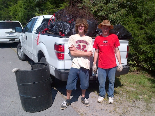 Two volunteers haul trash collected Sept. 7, 2013 from the Hurricane Creek Launching Area at J. Percy Priest Lake in La Vergne, Tenn.