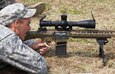 """FORT RILEY, Kan.—Sgt. William Jones, an infantryman of Company. A, 2nd Bn., 16th Inf. Regt. 4th IBCT, 1st Inf. Div., fires M110 Semi Automatic Sniper System at a target downrange on Aug. 16. Jones is one of more than 40 Soldiers of the """"Dragon"""" Brigade that received a month long block of instruction to increase their ability to effectively engage and destroy enemy targets. (U.S. Army photo by Sgt. Scott Lamberson, 4th IBCT PAO)"""