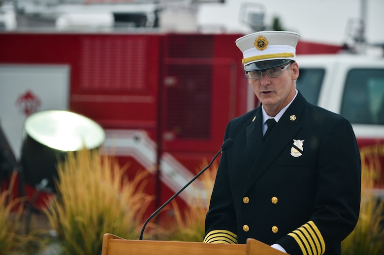 Tim Bosch, 460th Fire and Emergency Services chief, speaks during the Patriot Day and National Day of Remembrance ceremony Sept. 11, 2013 at the 460th Space Wing headquarters building on Buckley Air Force Base, Colo. During the ceremony, Team Buckley remembered those who died during the attacks 9/11 on the World Trade Centers in New York, Pentagon and on United Airlines Flight 93. (U.S. Air Force photo by Staff Sgt. Paul Labbe/Released)
