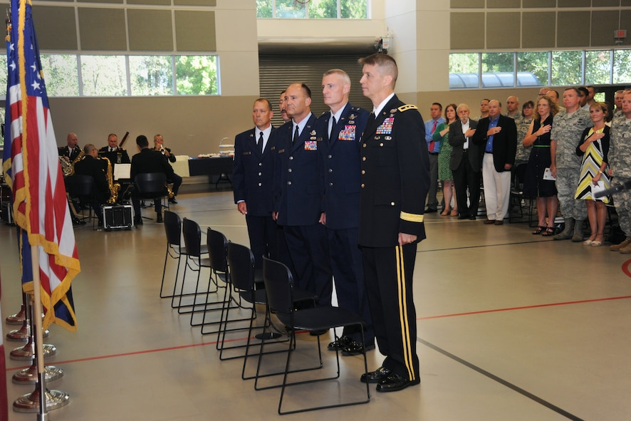 """Members of the official party stand at attention during the playing of the National Anthem, during the Change of Command and State Command Chief Change of Authority ceremony, Oregon Air National Guard, held at the Anderson Readiness Center, Salem, Ore., Sept. 8, 2013. (right to left) Maj. Gen. Daniel Hokanson, Oregon Adjutant General, Brig. Gen. Steven Gregg, Commander, Oregon Air National Guard, Brig. Gen. Michael Stencel, Assistant Adjutant General – Air, Oregon Air National Guard, Command Chief Master Sgt. Mark Russel, State Command Chief Master Sgt., Oregon Air National Guard, and Chief Master Sgt. Patrick """"Andy"""" Gauntz, 116th Air Control Squadron Maintenance Superintendent. (Air National Guard photo by Tech. Sgt. John Hughel, 142nd Fighter Wing Public Affairs/Released)"""