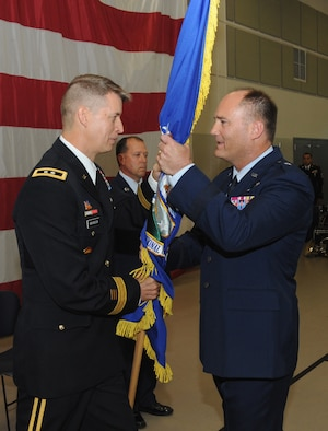 Brig. Gen. Michael Stencel (right) receives the colors of the Oregon Air National Guard flag from Maj. Gen. Daniel Hokanson (left), Oregon Adjutant General, during the Change of Command ceremony of the Oregon Air National Guard, held at the Anderson Readiness Center, Salem, Ore., Sept. 8, 2013. (Air National Guard photo by Tech. Sgt. John Hughel, 142nd Fighter Wing Public Affairs/Released)