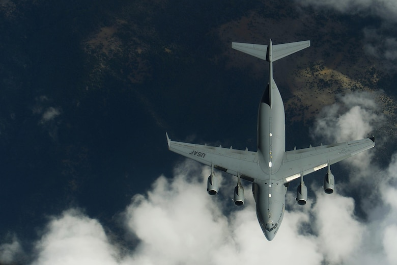 Members of the 191st Air Refueling Squadron conduct air refueling operations with a C-17 Globemaster III from Joint Base Lewis-McChord, Wash., Sept. 9, 2013. The 191st ARS routinely supports air operations across the western United States from their home station in Salt Lake City. (U.S. Air Force photo/Staff Sgt. Tim Chacon)