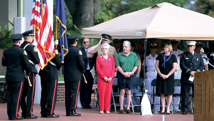 Service members of the Tri-Command leadership and distinguished guests pay respects as the City of Beaufort Fire Department presents the U.S. Flag during the annual City of Beaufort 9/11 Commerative Ceremony at the Henry C. Chambers Waterfront Park, Sept. 11.