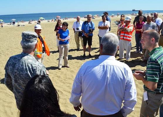 At Sea Bright, New Jersey, Lynn Bocamazo of New York District speaks with Maj. Gen. Michael Walsh, the Army Corps' Deputy Commanding General for Civil and Emergency Operations during a group visit to the northern most part of the beach nourishment project.  Discussed was what occurred during Sandy and areas exposed to tidal flooding from the Shrewsbury River on the backside of the Borough.