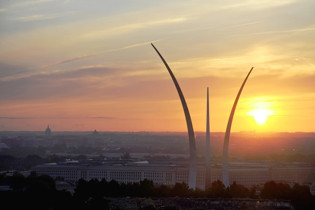 The sun rises behind the Air Force Memorial, the Pentagon, and the Washington, D.C. , skyline in Arlington, Va., Aug. 25, 2013. Since its formal dedication Oct. 14, 2006, the memorial has been a place of pride and honor for all the men and women who served and continue to serve the Air Force and its heritage organizations. (U.S. Air Force photo/Tech. Sgt. Peter R. Miller)