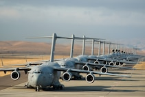 """A 22-aircraft """"freedom launch"""" took place Sept. 11, 2013, at Travis Air Force Base, Calif. Seven C-17 Globemaster IIIs, 11 KC-10 Extenders and four C-5B Galaxies from the 60th Air Mobility Wing lined up in what is historically referred to as an """"elephant walk,"""" then launched consecutively over 36 minutes to take part in Air Mobility Command missions. The first plane in the lineup, a C-17, launched at 8:46 a.m., the same time terrorists crashed American Airlines Flight 11 into the north tower of the World Trade Center in New York City 12 years earlier. (U.S. Air Force photo/Ken Wright)"""
