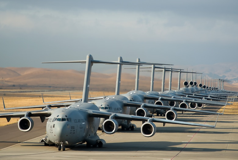 "A 22-aircraft ""freedom launch"" took place Sept. 11, 2013, at Travis Air Force Base, Calif. Seven C-17 Globemaster IIIs, 11 KC-10 Extenders and four C-5B Galaxies from the 60th Air Mobility Wing lined up in what is historically referred to as an ""elephant walk,"" then launched consecutively over 36 minutes to take part in Air Mobility Command missions. The first plane in the lineup, a C-17, launched at 8:46 a.m., the same time terrorists crashed American Airlines Flight 11 into the north tower of the World Trade Center in New York City 12 years earlier. (U.S. Air Force photo/Ken Wright)"