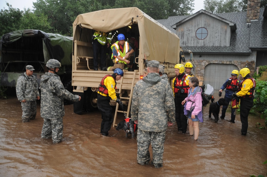 Colorado National Guardsmen respond to floods in Boulder County, Colo., Sept.12, 2013. The guardsmen are working with local agencies to help citizens in the area affected by the flooding by evacuating people using high-clearance vehicles.
